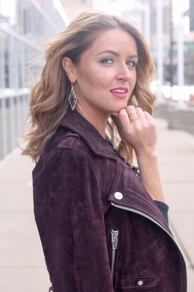 suede moto jacket and black diamond earrings