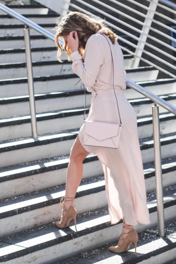 blush satin wrap dress and nude pumps