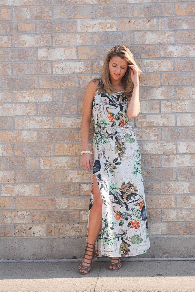 Amber from every once in a style wearing a tropical print maxi dress and caged heels