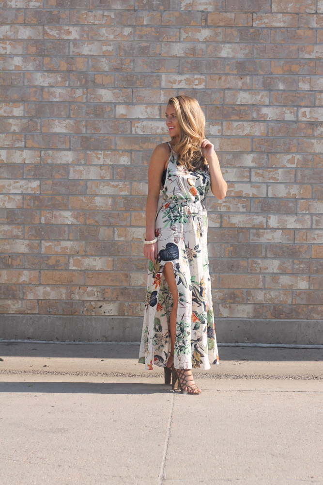 Amber from every once in a style in a tropical print maxi dress with a high slit