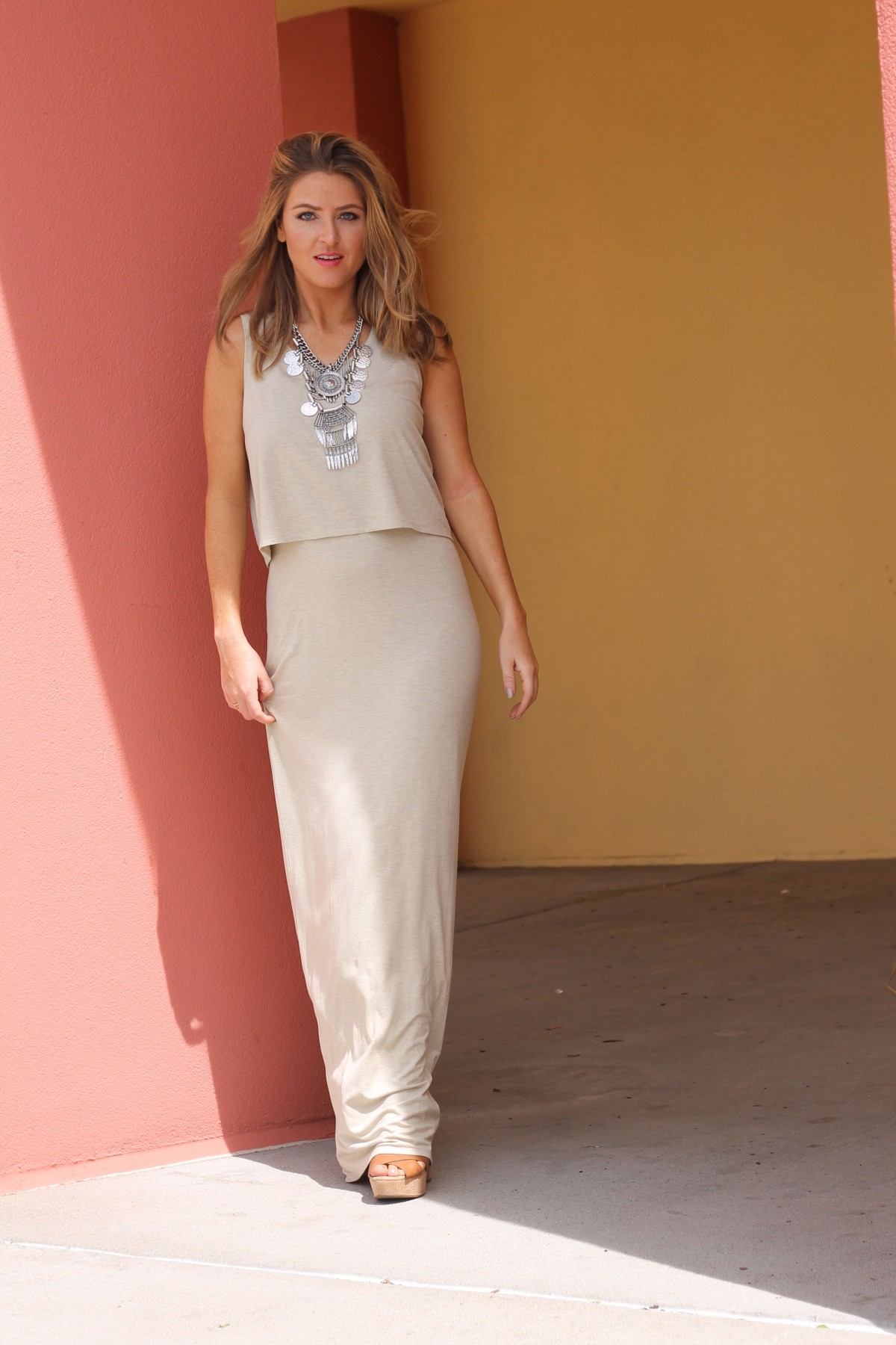 Amber from every once in a style in a charming charlie nude maxi dress and statement necklace