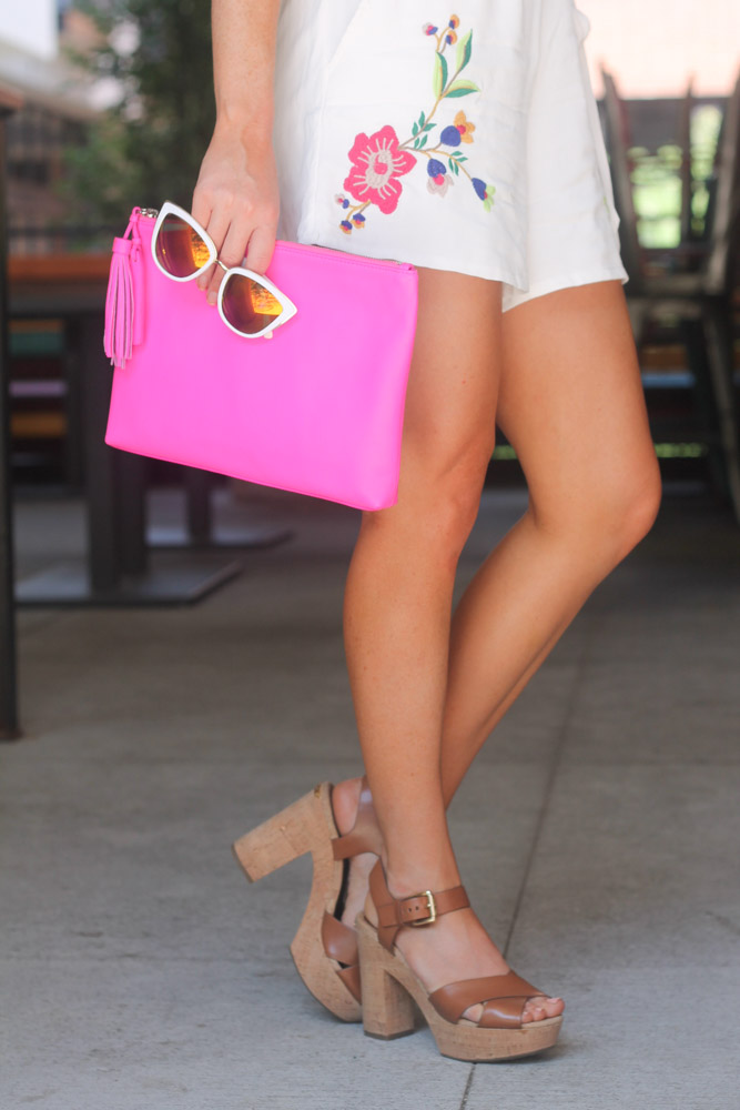 hot pink clutch and mirrored cat eye sunglasses