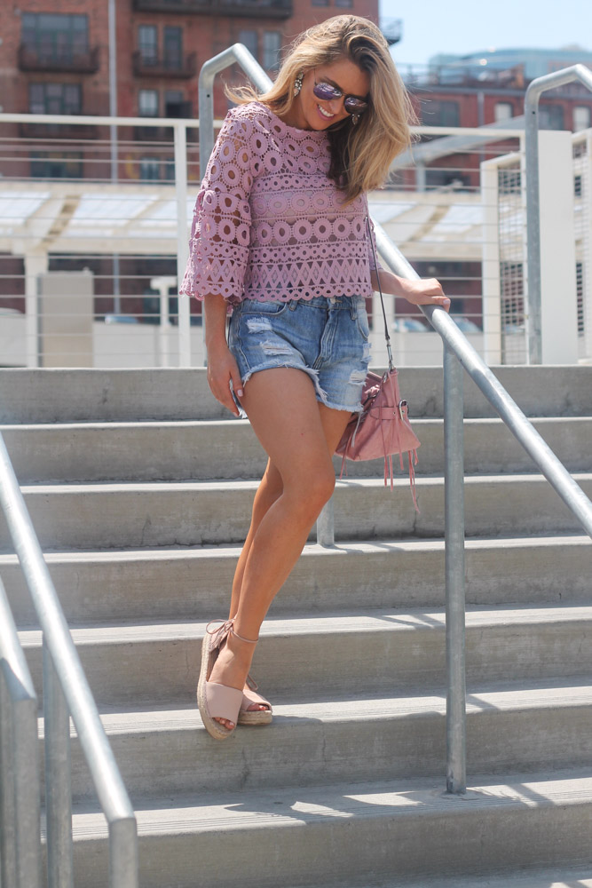 Amber from Every Once in a style wearing a circle crochet lavender top from chicwish and blankNYC denim shorts
