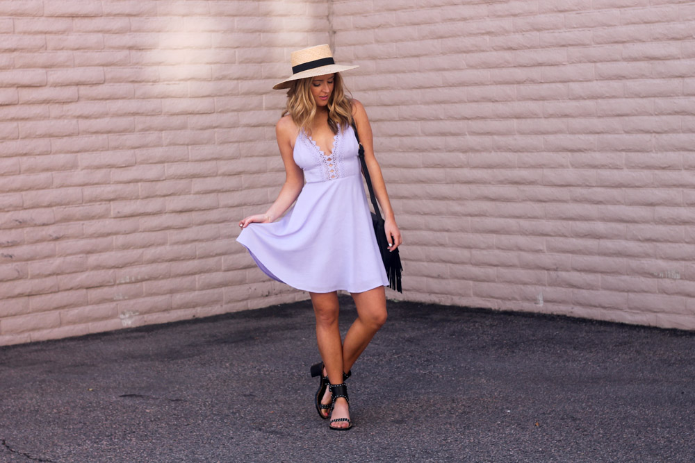Amber from every once in a style wearing a Lush lavender dress and boater hat