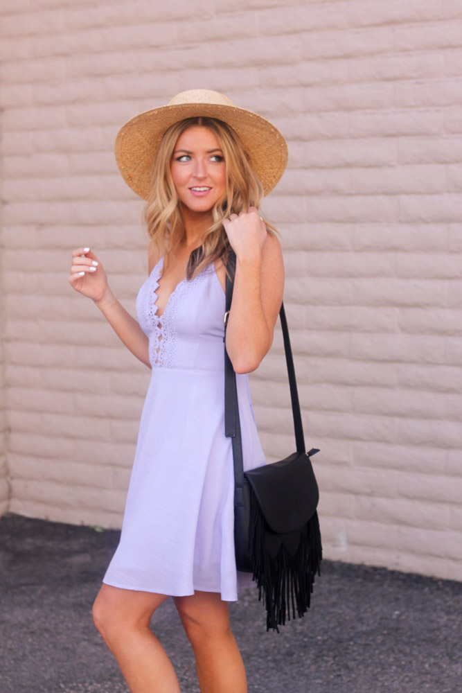 Amber from every once in a style wearing a Lush lavender dress and boater hat  sole society fringe bag