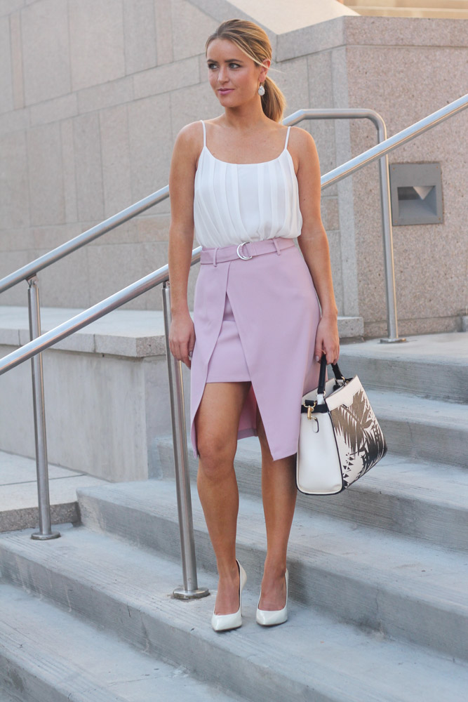 amber from every once in a style wearing a chic wish pink belted skirt office attire