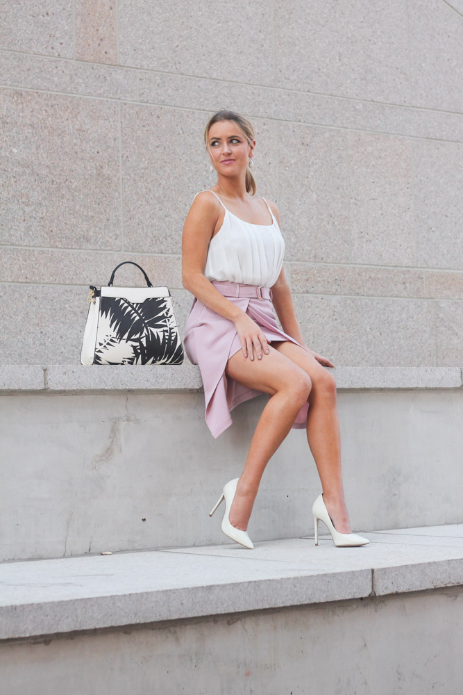 amber from every once in a style wearing a pink skirt from chic wish and a palm print charming charlie bag