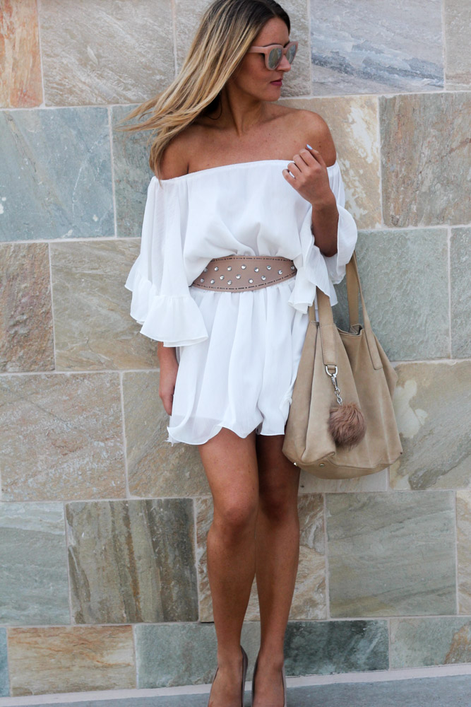 amber from every once in a style wearing chic wish white ruffle off the shoulder romper