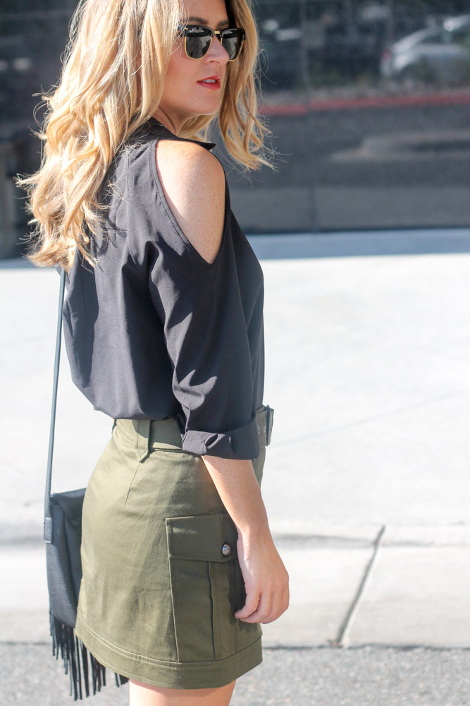 amber from every once in a style wearing cold shoulder black top from SHeIn and olive military skirt