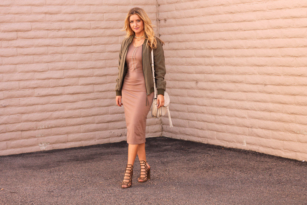 Amber wilkerson from every once in a style wearing make me chic nude dress and olive bomber jacket