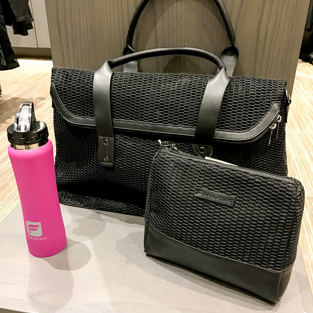 fabletics grip tote, prep toilet pouch and a stainless pink water bottle