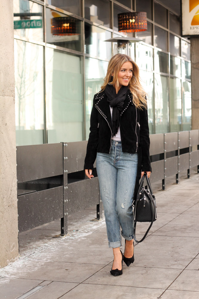 Amber from Every Once in a Style is wearing a moto jacket , levi's and black steve madden pumps