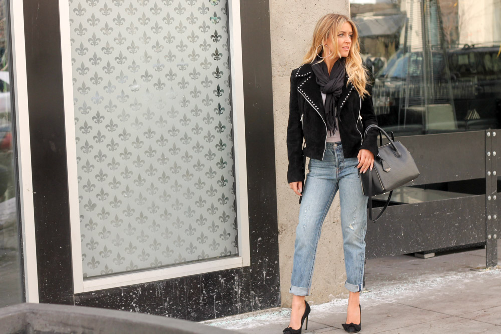 Amber from Every Once in a Style is wearing a studded bebe moto jacket