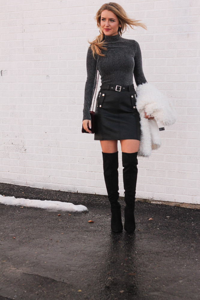 amber from every once in a style is wearing guess akera Over -the knee boots