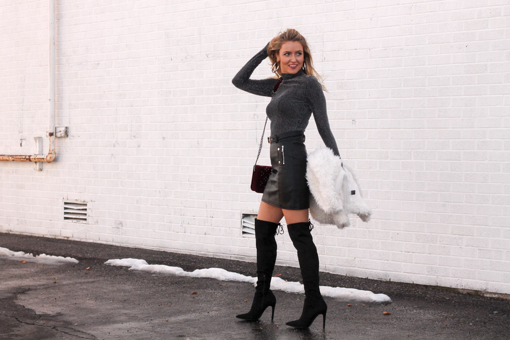 amber from every once in a style is wearing a toyshop skirt and a bcbg top with a velvet bag