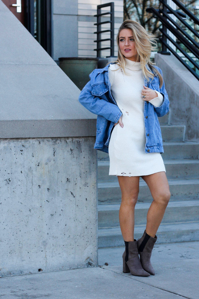 Amber from Every Once in a Style is wearing Guess booties a sweater dress and a jean jacket