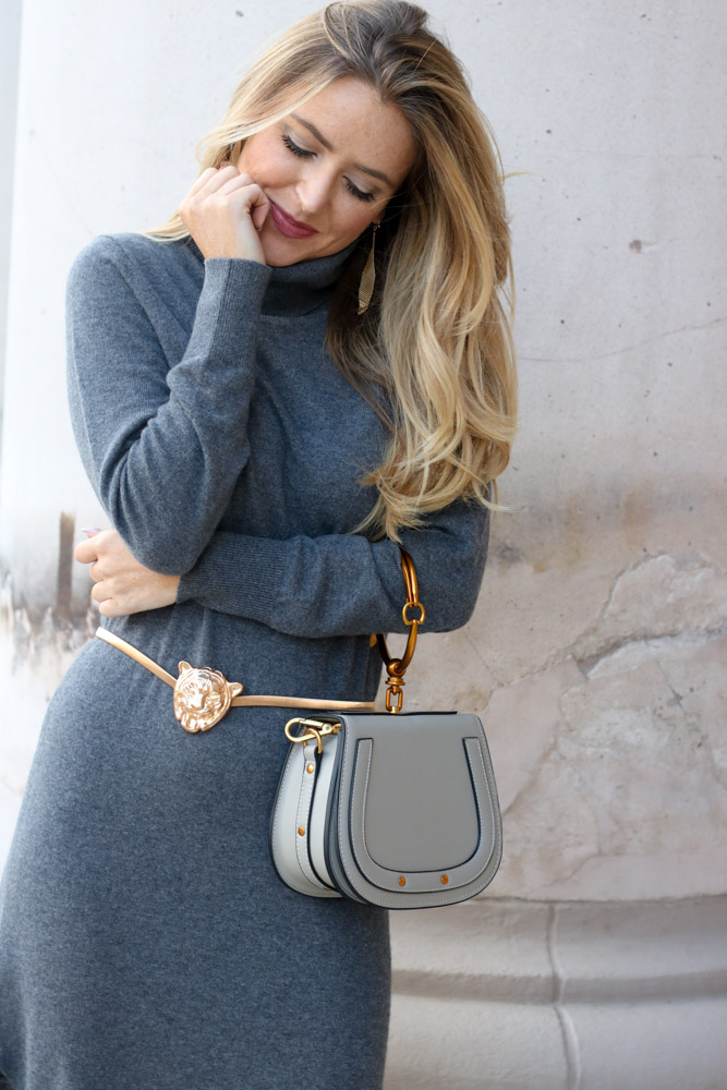amber from every once in style is wearing a sweater dress from banana republic